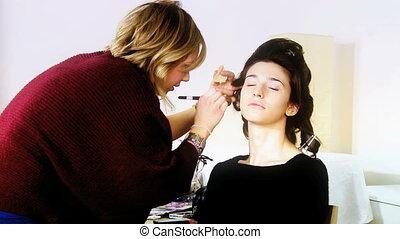 Fashion model getting makeup - Before photo shoot makeup...