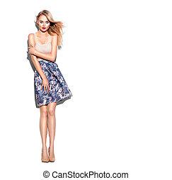 Fashion model girl full length portrait dressed in short skirt and beige top