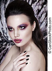 Fashion Model Girl Portrait with Red and Orange Makeup. Hairstyle.