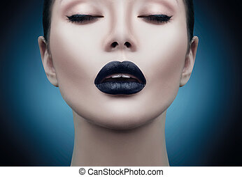 Fashion model girl portrait with trendy gothic black makeup