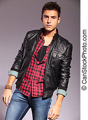 fashion model in casual clothes and leather jacket