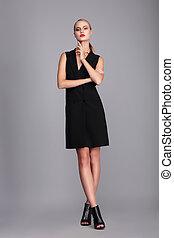Fashion model in dress.