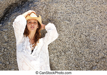 Fashion model in white summer dress and hat