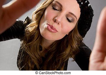 Fashion Model Kissing Towards Camera