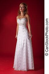 Fashion model lovely female in bridal dress posing in studio