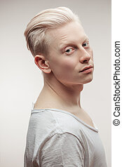 Fashion model male isolated on white. Handsome albino guy closeup.
