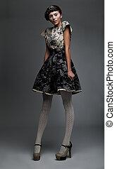 Fashion model nice girl in retro dress looks like doll