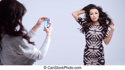 Fashion model posing for a photograph - Fashion model in a...