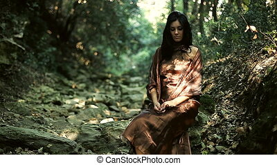 Fashion model posing in forest - Female model posing with...