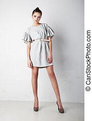 Fashion model pretty woman standing in studio