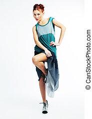 Fashion model red hair girl in modern dress posing