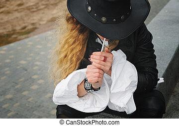 Fashion model smoking cigarette