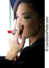Fashion model smoking red lipstick