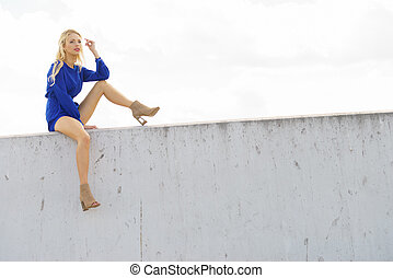 Fashion model wearing blue jumpsuit
