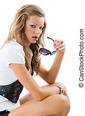 Fashion model with big sun glasses.