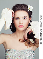 Fashion Model with Bridal Hairstyle. Beautiful Hair and White Flowers