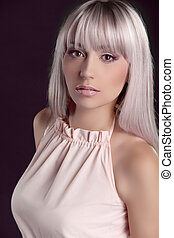 Fashion model with colored  straight hair isolated on black background. Beauty photo