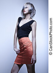 Fashion model with edgy haircut posing in studio
