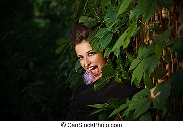 Fashion model woman in forest