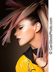 Fashion model woman. Portrait of beautiful party girl with trendy make-up, haircut.