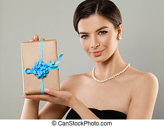 Fashion Model Woman with Gift on Background