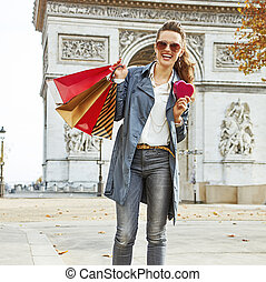 fashion-monger in Paris showing heart shaped box of chocolates