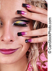 Fashion multicolored make-up and beauty purple manicure of fingernails