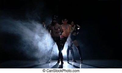fashion Night club striptease dancer. Strong men and woman. Slow motion, smoke