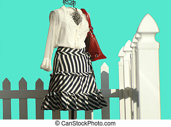 Fashion Outfit Displayed by A Fence