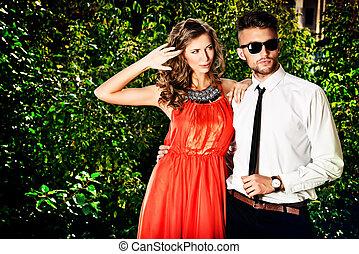 fashion pair - Beautiful fashionable couple standing...