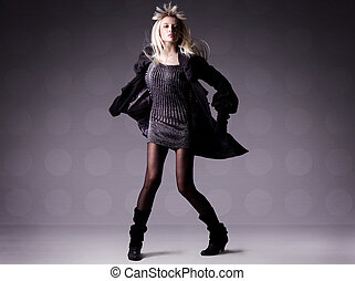 Fashion photo of a beautiful dancing blond girl