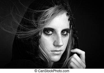 Fashion photo of a beautiful girl with hood