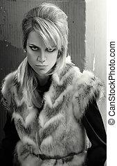Fashion photo of a girl waering fur
