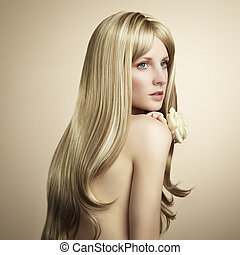 Fashion photo of a young woman with blond hair