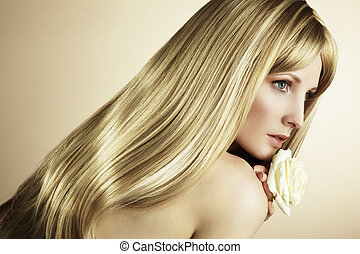 Fashion photo of a young woman with blond hair. Close-up...