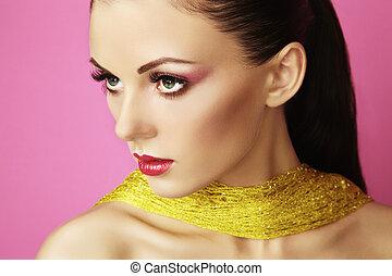 Fashion photo of  beautiful woman on  pink background