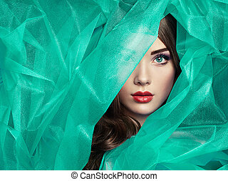 Fashion photo of beautiful women under turquoise veil
