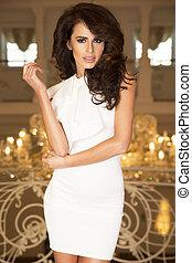 Fashion photo of elegant brunette woman.