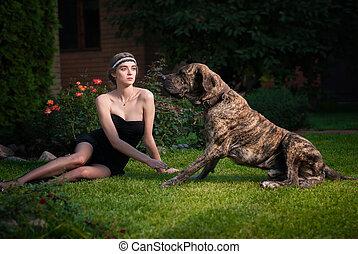 Fashion photo of elegant woman with a big dog