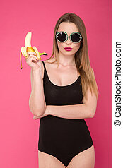 Fashion photo of glamourous girl with banana