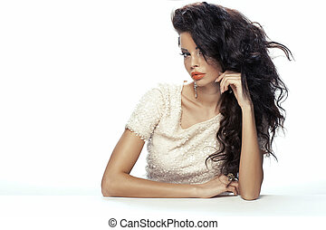 Fashion photo of the girl wearing shiny dress