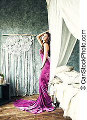Fashion Photo of Young Beautiful Caucasian Brunette in Gorgeous Dress