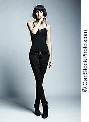 Fashion photo of young long-legged woman
