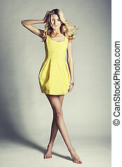 Fashion photo of young magnificent woman. Girl posing....