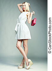 Fashion photo of young magnificent woman. Girl with handbag...