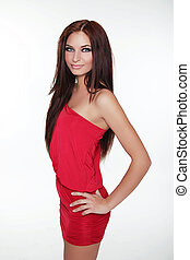 Fashion photo of young magnificent woman in red dress. Girl posing. Studio photo
