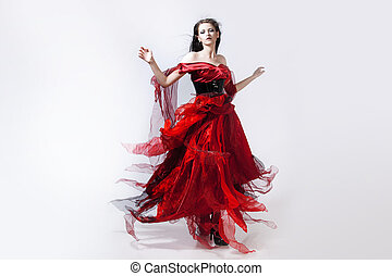 Fashion photo of young magnificent woman in red dress....