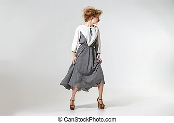Fashion photo of young posing magnificent woman