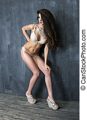 Fashion photo of young sensual woman in beige underwear