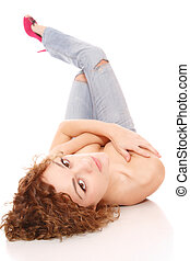 Fashion photo of young sensual woman in jeans